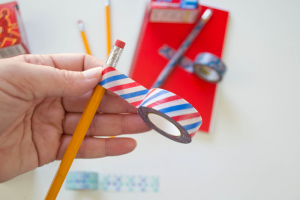 adhere washi tape to pencils